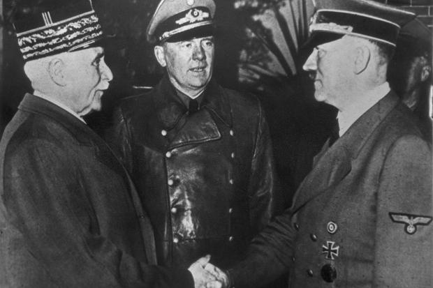 Marshal Philippe Pétain shakes hands with Adolf Hitler watched by interpreter Colonel Schmidt | Hulton Archive/Getty Images