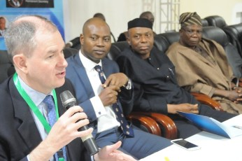L-R: Robert Yates, the Project Director of the Universal Health Coverage (UHC) Policy Forum at the Chatham House, the Ondo State Commissioner for Health, and, Governor Olusegun MImiko at the Ondo State Council on Health 2016 (#OndoSCH2016) at the International Conference and Event Centre (The Dome) Akure On January 26, 2016 | OndoTv