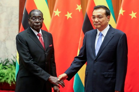 Zimbabwe's President Robert Mugabe (L) and China's Premier Li Keqiang shake hands during their meeting at the Great Hall of the People in Beijing 26 August, 2014. | REUTERS/Diego Azubel/Pool