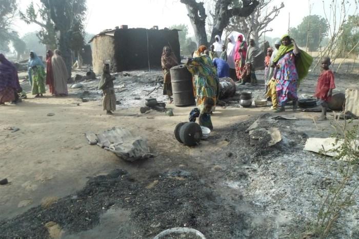 Women and children look at burnt out houses following an attack by Boko Haram in Dalori village 5 kilometers (3 miles) from Maiduguri, Nigeria, Sunday Jan. 31, 2016. | AP/Jossy Ola