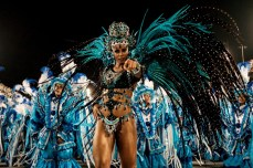 TOPSHOT - Revellers of Unidos da Tijuca samba school perform during the first night of the carnival parade at Sambadrome in Rio de Janeiro, Brazil on February 8, 2016. A / AFP / YASUYOSHI CHIBAYASUYOSHI CHIBA/AFP/Getty Images