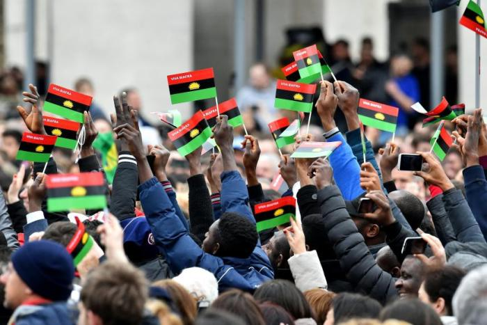 Pro-Biafra activists, IPOB, wave flags in St. Peter's Square at the Vatican, February 28. Pope Francis greeted spoke of the activists as indigenous peoples of Biafra during his Angelus address. | Vincenzo Pinto/AFP/Getty Images