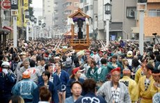 Believers of the Wakamiya Hachimangu Shrine carry portable shrines bearing phalluses during the Kanamara Festival in Kawasaki, a suburb of Tokyo on Sunday, April 3, 2016.