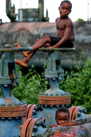 Niger Delta Crisis: A child pictured on top of the oil instationals which litter the oil rich region