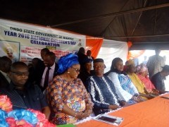 Governor Segun Mimiko (in blue) and wife, Kemi oon his left) at the Children's Day celebration in Ondo State on May 27, 2016