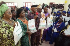 Governor Segun Mimiko of Ondo State (m) with his wife, Kemi (2nd left) at a government economic palliative distribution event | Ondo TV