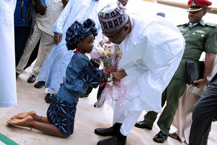 President Buhari received a flower from a girl at Osun in celebration of Osun at 25 years anniversary on 1st Sept 2016 | Femi Adesina/Facebook