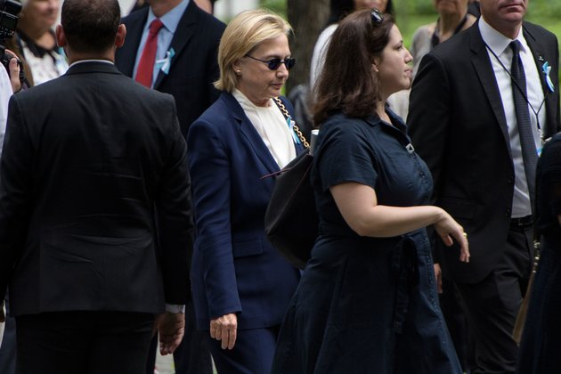 US Democratic presidential nominee Hillary Clinton arrives for a memorial service at the National 9/11 Memorial on September 11, 2016 in New York. | AFP/Brendan Smialowski/Getty Images