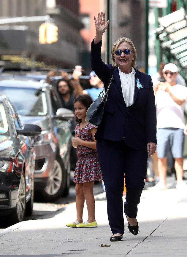 Democratic presidential nominee former Secretary of State Hillary Clinton waves as she leaves the home of her daughter Chelsea Clinton on September 11, 2016 in New York City. | Justin Sullivan/Getty Images