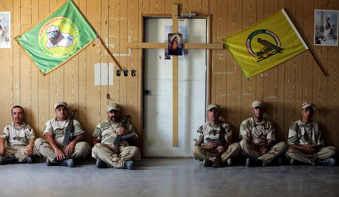 Iraqi Christians volunteers, who have joined Hashid Shaabi (Popular Mobilization), allied with Iraqi forces against the Islamic State, rest during training in a military camp in Baghdad, July 1, 2015. | REUTERS/Stringer