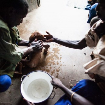 Family members wash Fana's body at their home in Banki, Nigeria, before her burial. | The Washington Post