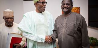President Muhammadu Buhari (middle) shakes hands with Femi Adesina, his spokesperson