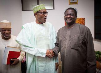 President Muhammadu Buhari (middle) shakes hands with Femi Adesina, his spokesperson
