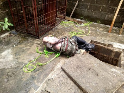 The body of a yet to be identified Jumia agent in a septic tank