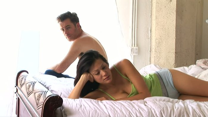couple unhappy fighting bed