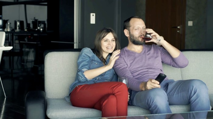 Young couple watching TV love