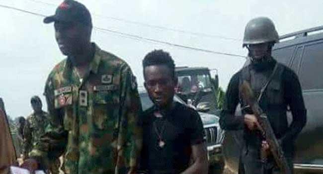 Karowei (middle) militant