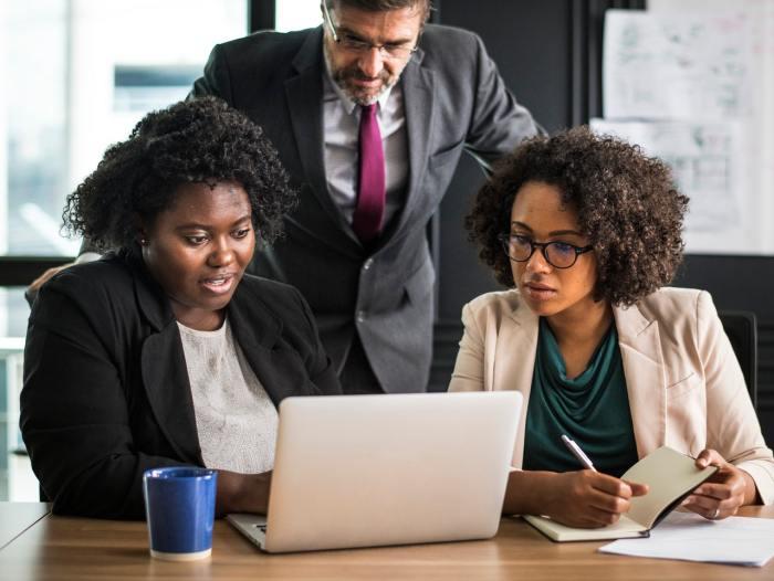 monday morning office team work laptop women workplace woman businessman businesswoman