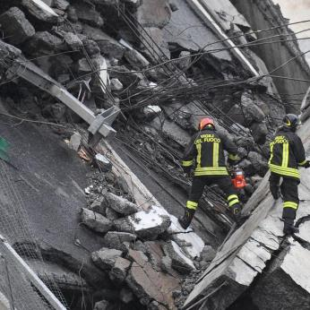 A view of the collapsed Morandi highway bridge in Genoa, Tuesday, Aug. 14, 2018. Italian authorities say that about 10 vehicles were involved when the raised highway collapsed during a sudden and violent storm in the northern port city of Genoa, while private broadcaster Sky TG24 said the collapsed section was about 200-meter long (650 feet). | Luca Zennaro/ANSA via AP