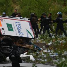 A view of the collapsed Morandi highway bridge in Genoa, Tuesday, Aug. 14, 2018. Italian authorities say that about 10 vehicles were involved when the raised highway collapsed during a sudden and violent storm in the northern port city of Genoa, while private broadcaster Sky TG24 said the collapsed section was about 200-meter long (650 feet).   Luca Zennaro/ANSA via AP