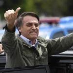 Jair Bolsonaro waves to the crowd after voting in Rio de Janeiro on October 28. Photo: Mauro Pimentel/AFP/Getty Images