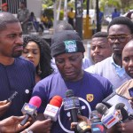 Deji Adeyanju (left) with Charly Boy (middle) as the Our Mumu Don Do and Concerned Nigerians movements stage a anti-government protest in Abuja in 2017