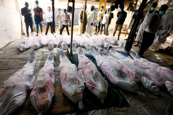 Members of the Islamic Movement of Nigeria preparing the bodies of members killed when the Nigerian Army opened fire during the group's protests in the capital Abuja this week.CreditCreditAfolabi Sotunde/Reuters