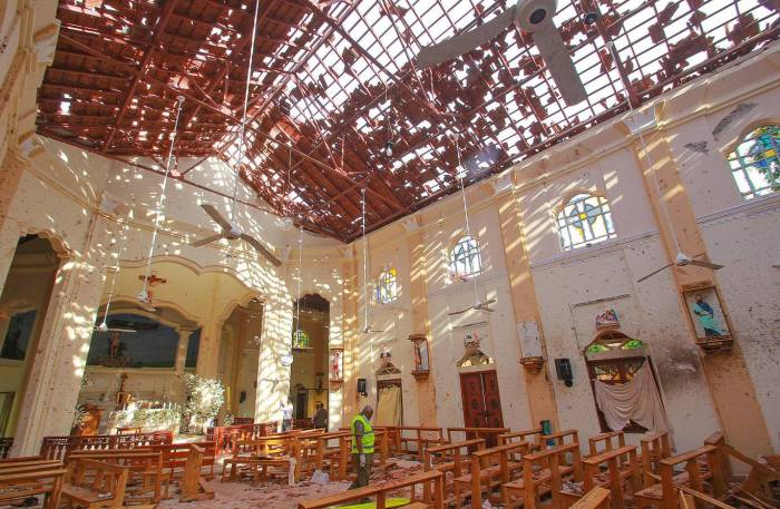 The damaged interior of a church in Negombo, Sri Lanka following a bombing attack Reuters