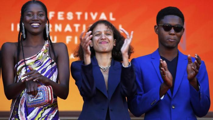 """Director Mati Diop (center) on May 16, 2019 in Cannes, where her film """"Atlantic"""" is competing for the Palme d'Or."""