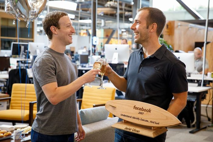 Facebook founder, Mark Zuckerberg with an engineer in the company