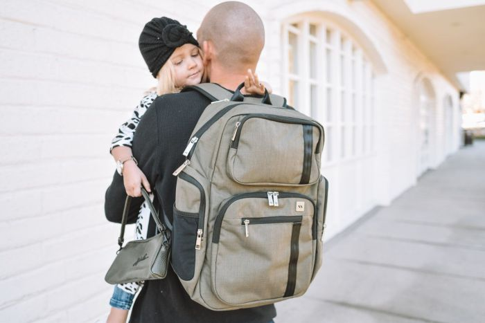 travelling mom dad father  baby backpack