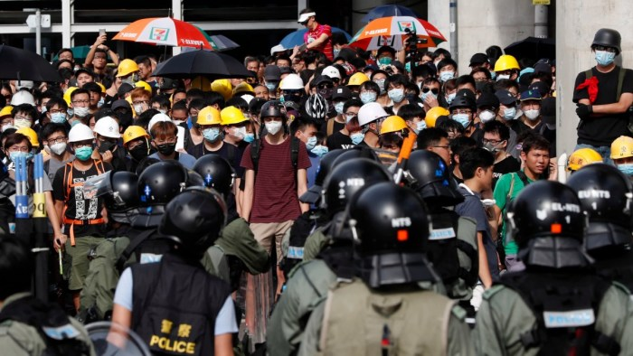 Riot police face off protesters at Yuen Long district in Hong Kong on July 27, 2019. © AP
