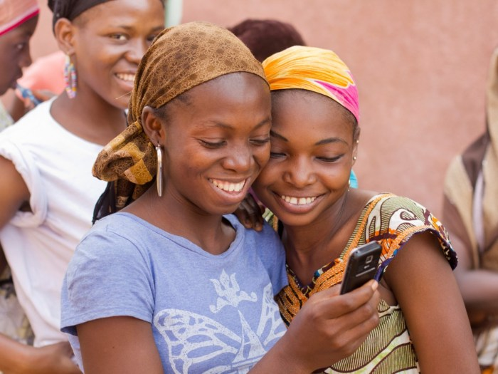 African youth using the internet on a smart phone. Photo Source: MGI Africa Lions 2013