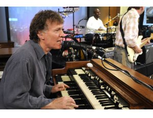 Steve Winwood at the Hammond B-3 with Karl Vanden Bossche on drums and Jose Neto, guitar, in background.