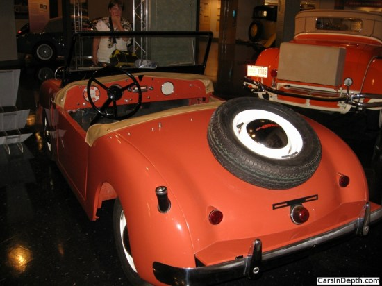 Famed architect Frank Lloyd Wright's 1952 Crosley Super Roadster, in Taliesin Red, just like his Cord L-29 in the background