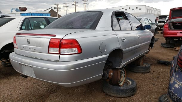 2001 Cadillac Catera in Colorado junkyard, RH rear view - ©2021 Murilee Martin - The Truth About Cars