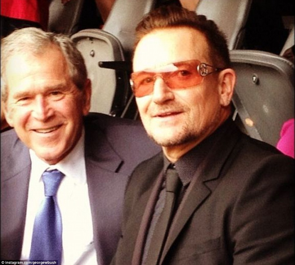 Bono and Bush at the Mandela memorial service in south africa, both obviously in good spirit. Click to enlarge