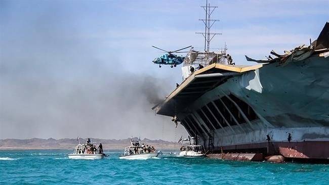 IRGC marines board a scale replica of a US Aircraft carrier during drills Wednesday. Click to enlarge