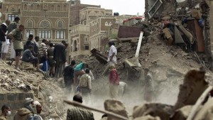 People search for survivors under the rubble of houses in the old city of Yemeni capital Sana'a, following a Saudi airstrike, June 12, 2015. Click to enlarge