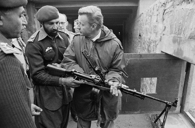 Former U.S. National Security Advisor Zbigniew Brzezinski with Col Tim Osman aka Osama bin Laden. Click to enlarge