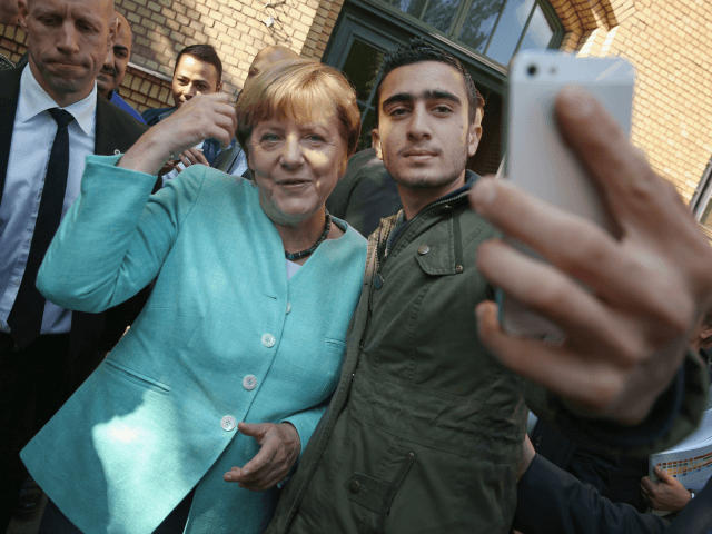 Angela Merkel poses for a migrant selfie. Click to enlarge