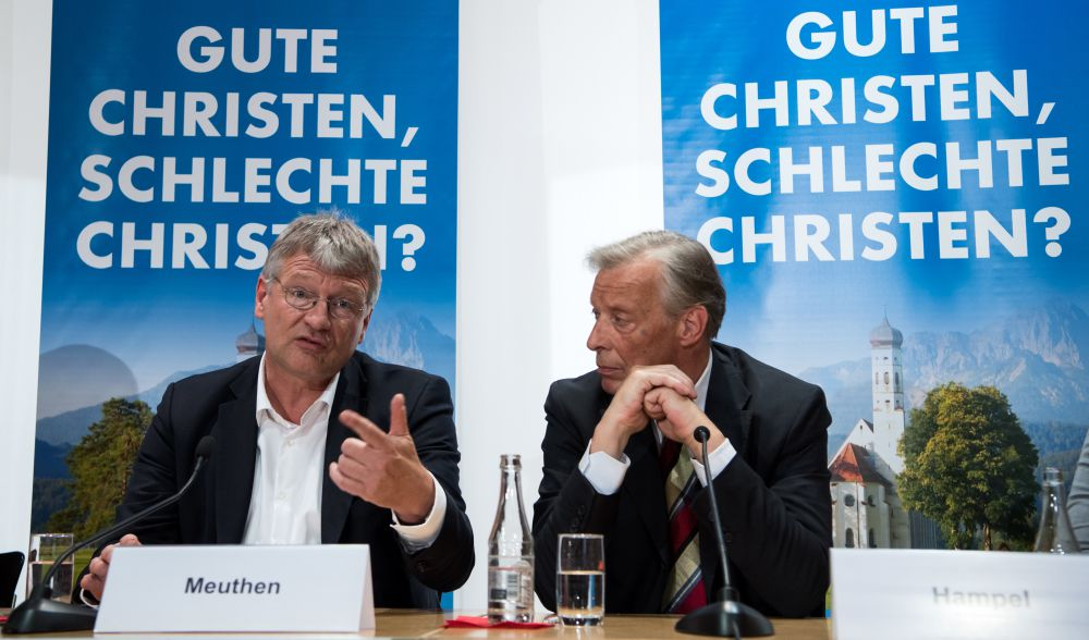 "AfD federal chairman Jörg Meuthen (l) and AfD board member Armin-Paul Hampel in front of signs reading ""Good Christians, bad Christians?"" Click to enlarge"