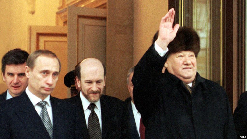 Boris Nikolayevich Yeltsin leaves the Kremlin on the day of his resignation, December 31 1999. Prime Minister Putin (second left) became acting president. Click to enlarge