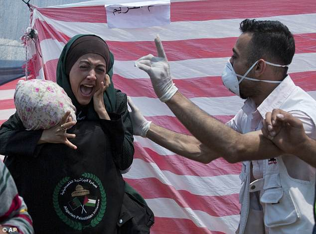 Palestinian woman crying for her dead children