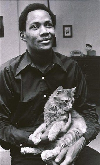 Young Frank Wills holds his cat