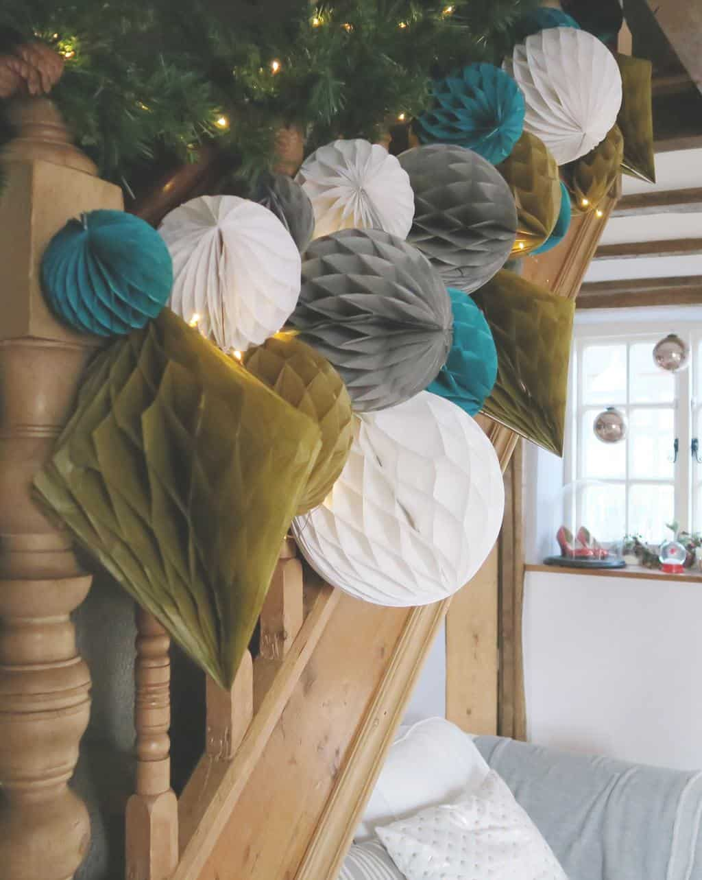 Decorating a Staircase with Honeycomb Balls and paper pom poms