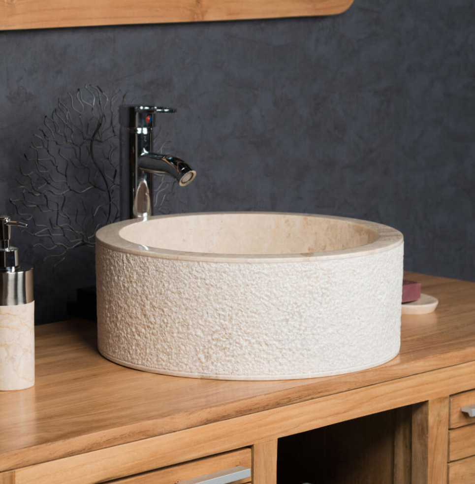 cream cylindrical stone sink with hammered outer finish 40 x 15cm