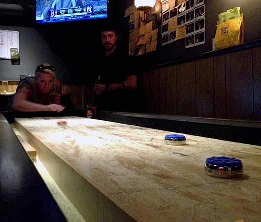 Once your delicious meal's complete activities such as shuffle board demand your attention. (Photo - K. Chandler)