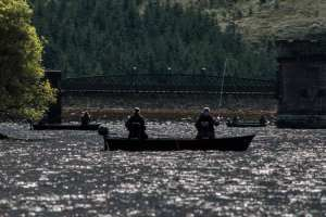 the fleet drifts in to the dam