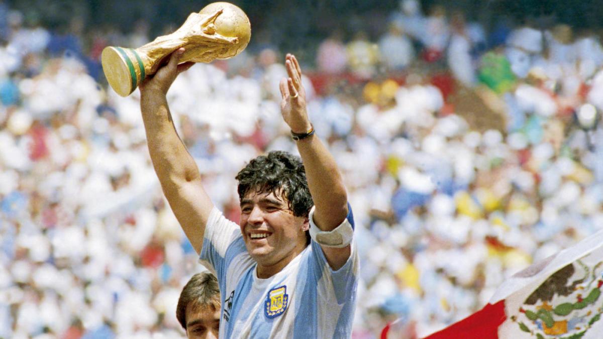 Diego Maradona holding the World Cup